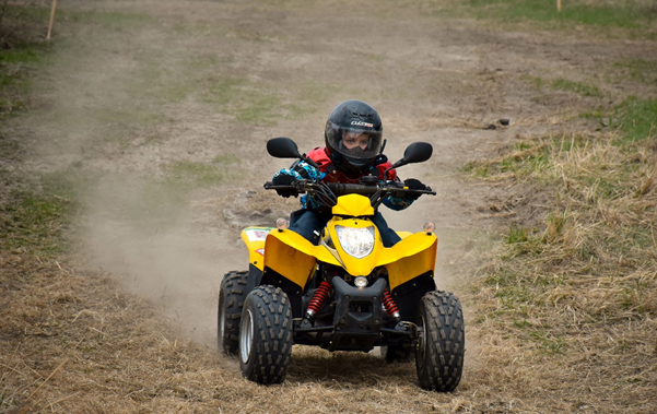 Child on a yellow electric quad bike